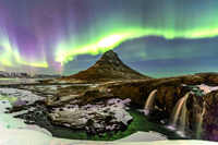 Icelandic tholos with northern lights in background, taken from web