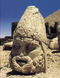 Image of a giant head taken from a postcard of the heads at Nemrut Kommagene in Turkey; it's been identified as Zeus-Oromasdes but in the PHANTACEA Mythos it's more reminiscent of Thrygragos Varuna Mithras
