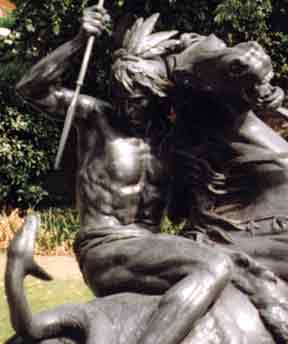 [A STATUE OF A NATIVE AMERICA RIDING A STALLION AND FIGHTING OFF AN ENORMOUS SNAKE WITH A SPEAR, REMINISCENT OF SUNDOWN AND RAVEN'S HEAD IN BATTLE, PHOTOGRAPHED IN LONDON ENGLAND BY JIM MCPHERSON, 2000]
